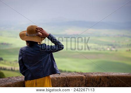 woman admiring green summer landscape