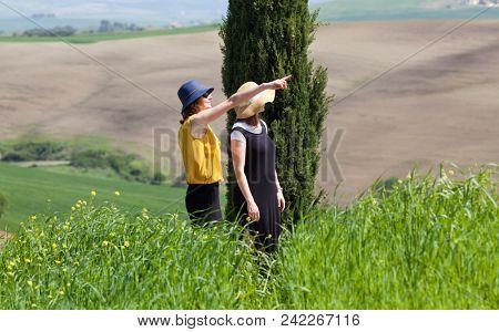 two women admiring green summer landscape,