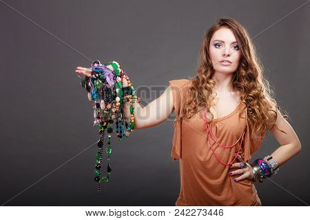 Pretty Young Woman Wearing Bracelets And Rings Holding Many Plentiful Of Precious Jewelry Necklaces