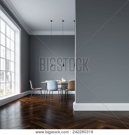 Gray Wall Dining Room Interior With A Wooden Floor, A Table With Several Types Of Pastel Color Chair