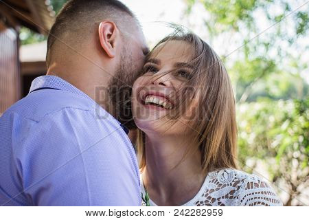 Young Man Whispering To Woman Or Girlfriend, Boyfriend Telling Surprising Secret To His Girl, Man Sa