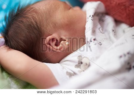 Newborn Baby With Earring Close Up View Sleeping
