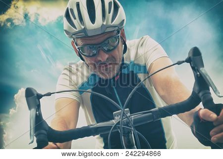 Cyclist in helmet riding proffersional bicycle outdoors