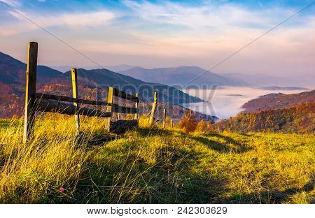 Beautiful Mountainous Landscape With Wooden Fence. Lovely Autumnal Scenery At Sunrise With Gorgeous