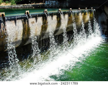 City concrete dam on Bosna river in Sarajevo on a lovely summer day poster