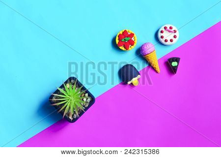 Tiny Cute Rubber Sweet Dessert On A Pink And Blue Sky Background. Copy Space