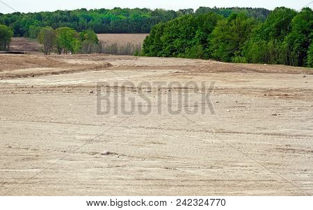 Deforestation Of Trees And Acres Of Land Leveled And Graded To Make Way For A New Subdivision