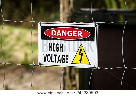 High Voltage Sign On A Fence Warning With Danger Of Electricity