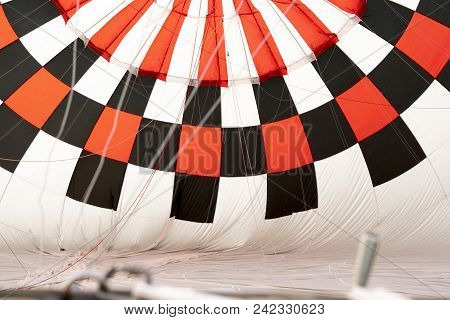 Hot Air Balloon Getting Ready To Take Off With A Red And Black Pattern