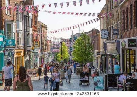 Windsor, Uk - May 5, 2018: High Street Of Windsor, Decorated With Flags And Lots Of People. Tourists