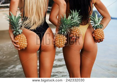 Two Incredibly Beautiful Sexy Model Girls In Bikini At The Seaside Of The Tropical Island, Blonde Br
