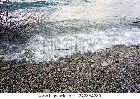 Waves Crash Against The Rocky Shoreline Of Little Traverse Bay, In Bay View, Michigan, During Octobe