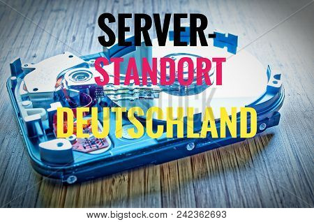 Hard Drive 3.5 Inches As A Data Storage With Motherboard On A Bamboo Table And In German Server Stan