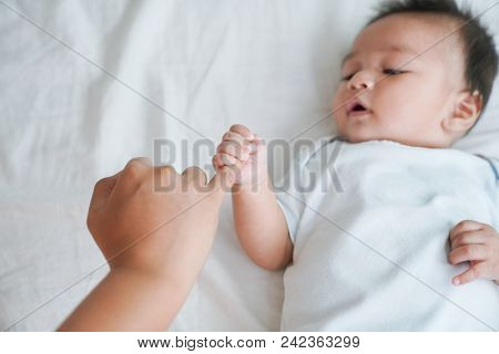 Mom And Baby Hands Promise Friendship Of Generations, New Family And Baby Protection From Mom Concep