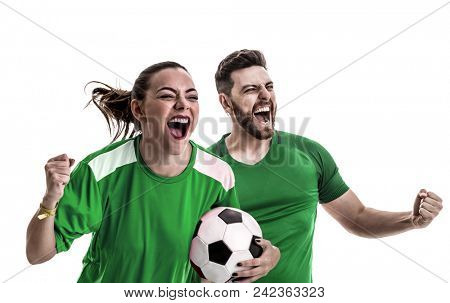 Young couple fan in green uniform celebrating