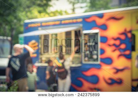 Vintage Blurred Food Truck Vendor With Customer Buy And Taste Variety Of Food