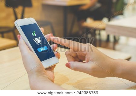 Concept Online Payment Mobile Technology. Hand Of Female Using Smartphone Touching Pay Button Mobile