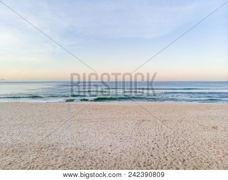 Low Drone Photo Barra Da Tijuca Beach During Sunrise, Sand Still In Shade.