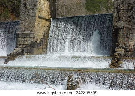 A Waterfall Weir In A Non-urban Scene Day.