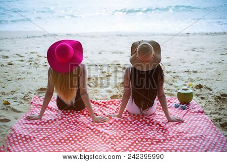 Young Couple Friend Women Sunbathe At The Beach; Summer Holiday And Relax Concept.