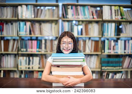 Education, School And People Concept - Cheerful University Students With Happy Read A Book And Repor