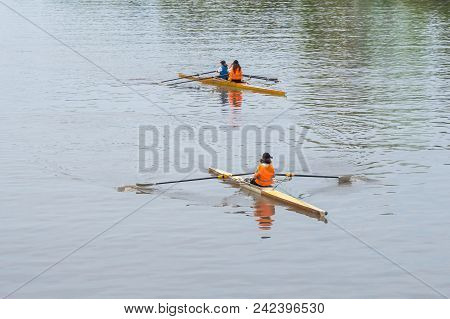 Young Sportsmen In A Boat, Rowing On The River Rioni, Poti, Georgia