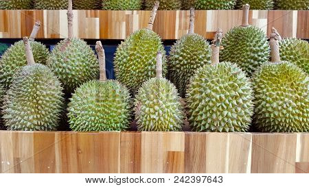 Durian Fruit Is Laid On Wooden Shelf Background