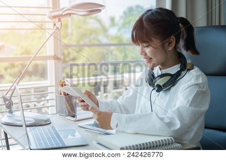 Student Learning Online Study Concept: Beautiful Asian Girl Listening With Headphones And Laptop, Si