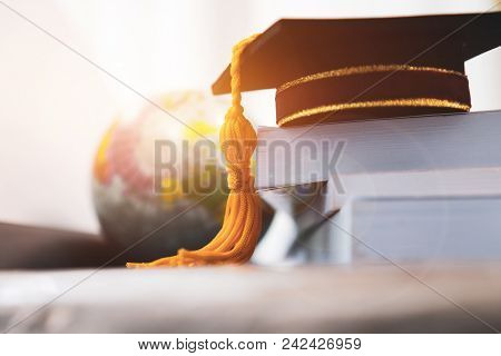 Graduated Or Graduation University Study Abroad International Conceptual, Master Cap On Books Stack