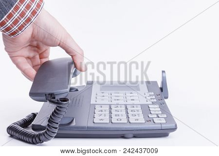 A Man Dressed In Suit Hangs Up Or Hangs A Phone Isolated On White.