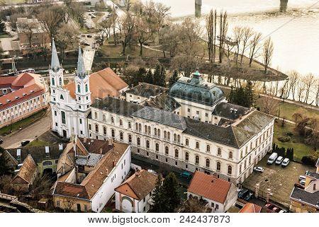 View From Esztergom Basilica. Saint Ignatius Church, Hungary. Yellow Photo Filter. Urban Scene. Reli