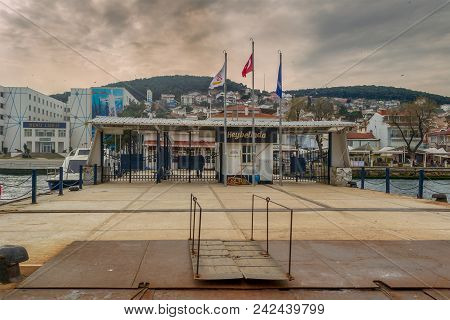Istanbul, Turkey - March 3, 2013: Heybeliada Ferry Terminal With Green Mountains And Houses On The B
