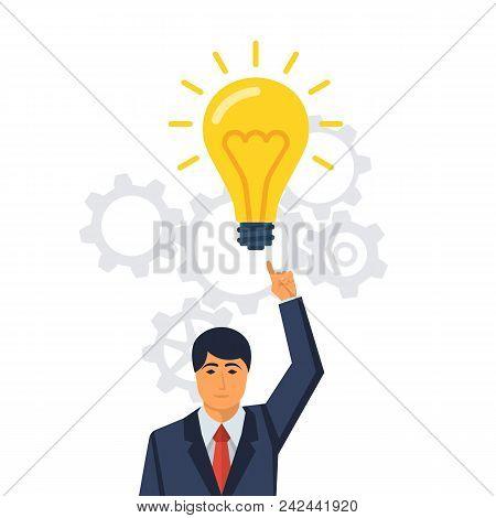 Businessman Points To A Big Light Bulb As A Symbol Big Idea. New Creative Idea. Problem Solution Met