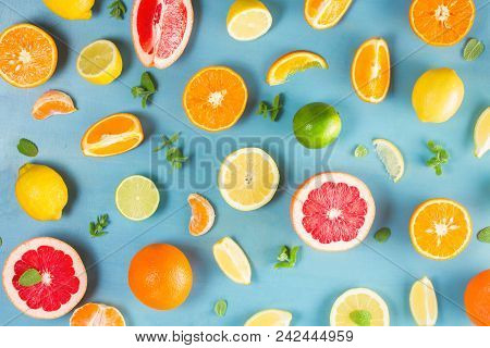 Citrus Food Falt Lay Pattern On Blue Background - Assorted Citrus Fruits With Mint Leaves