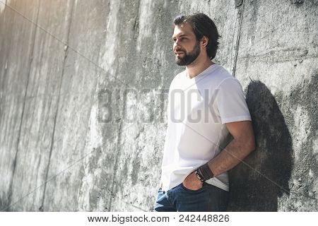 Quiet Loneliness. Calm Bearded Male Person Looking Into The Distance With Peacefulness While Standin