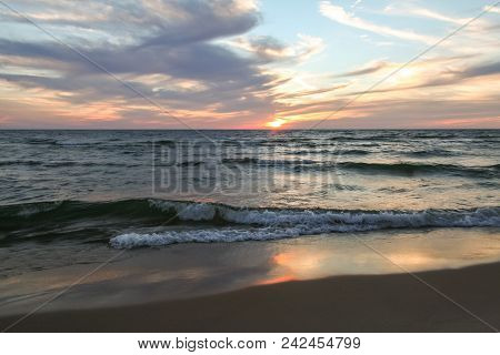 Beach Sunset On Lake Michigan.  Saugatuck, Mi, Usa.