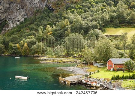 Landscape With Naeroyfjord, Mountains And Traditional Village House In Norway.
