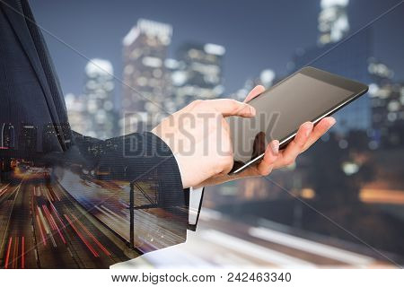 Side View Of Businessman Hands Using Touchpad On Blurry Night City Background. Communication And Tec