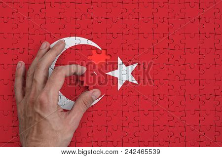 Turkey Flag  Is Depicted On A Puzzle, Which The Man's Hand Completes To Fold