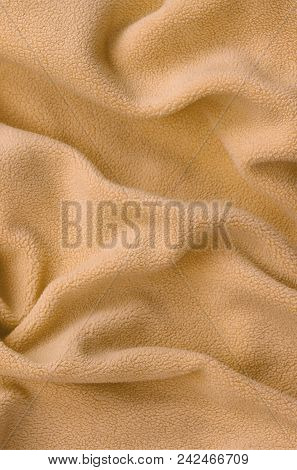 The blanket of furry orange fleece fabric. A background of light orange soft plush fleece material with a lot of relief folds poster