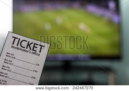 The World Cup Is On The Tv In The Hands Of A Ticket Office Bookmaker, Sports Betting, Close-ups, Cha