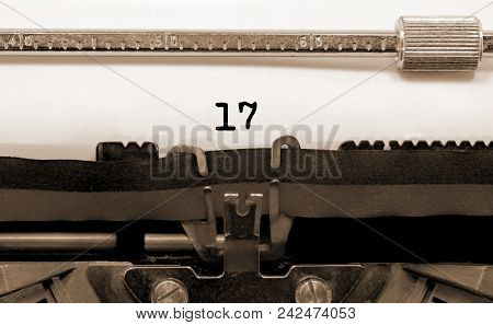 17 Number Text Written By An Old Typewriter On White Sheet