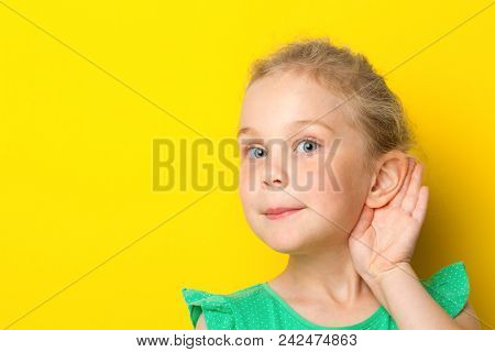 Gossip, Rumors, Whisper, Hearing Concept. Young Blonde Woman Putting Hand Ear To Hear Better. Studio