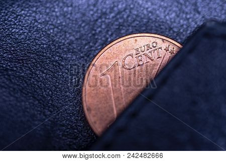 A Black Leather Wallet And One Cent Of Euro, To Symbolize Poverty, Bankrupt Or Thrift, Frugality And