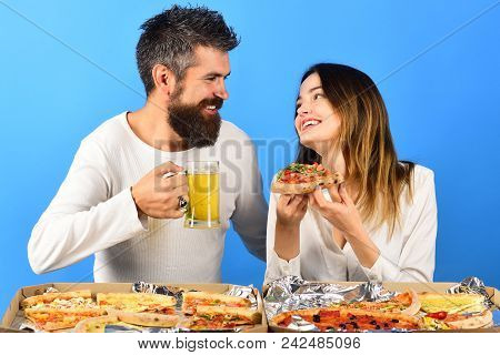 Romantic Couple Drinks Beer With Pizza At Home. Loving Couple Sitting At Table Enjoy Pizza. Loving C