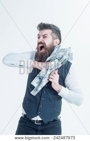 Portrait Of Corrupt Businessman Hiding Money In Jacket. Bearded Man Putting Money In Pocket. Corrupt