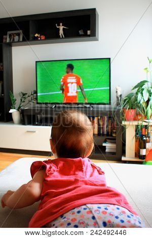 Baby Girl Watching A Soccer On Tv