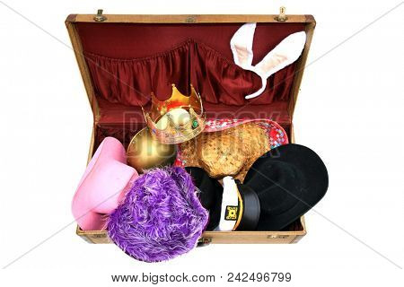 Vintage Suitcase. Old Retro Suitcase filled with funny dress up costumes and hats. isolated on white. room for text. costume trunk.