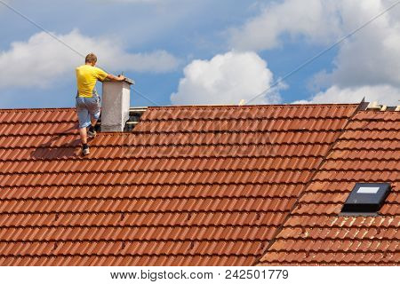 Man working on the roof of a building