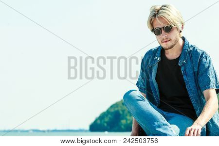 Vacation, Contemplation Concept. Nostalgic Man Sitting Relaxing And Enjoying Weather During Summerti